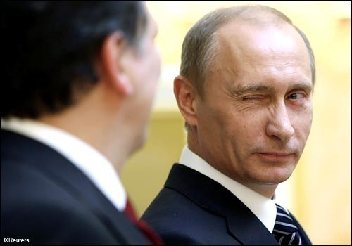 Russian Prime Minister Putin winks at EU Commission President Manuel Barroso in Moscow.