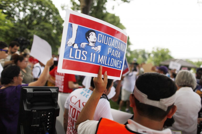 Members of immigrant-advocate groups and the Service Employees International Union march in June 2013 on Capitol Hill.