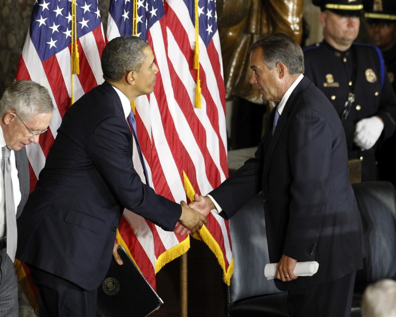 Obama and House Speaker John Boehner (R-Ohio) shake hands in February during the unveiling of a statue in honor of civil rights activist Rosa Parks.