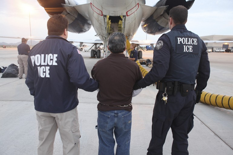 ICE agents escort Pedro Pimental Rios, a Guatemalan immigrant, to a plane bound for Guatemala's capital.