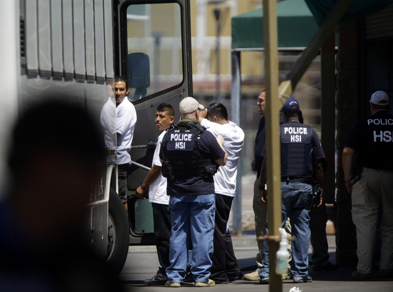 ICE agents detain workers after raiding a Phoenix car wash in August.