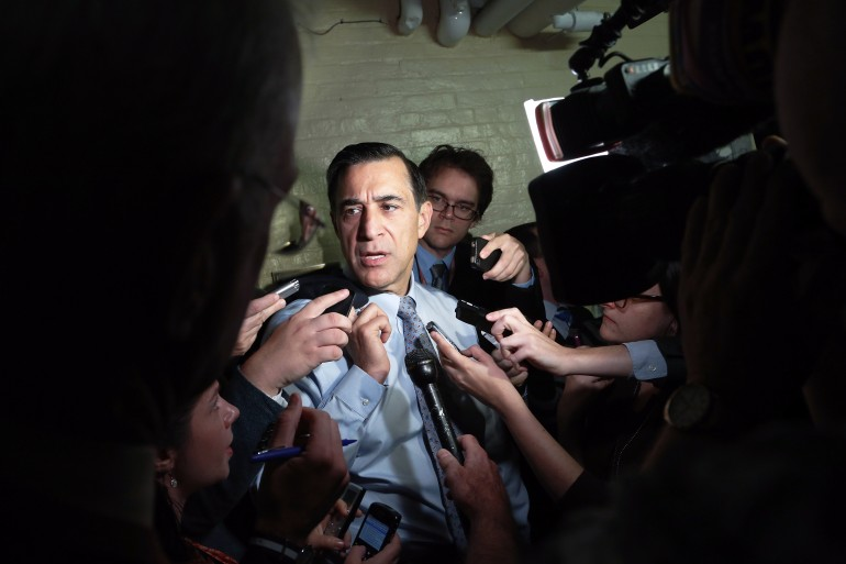 U.S. Representative Darrell Issa (R-CA) talks to reporters as he departs a House Republican caucus meeting at the U.S. Capitol in Washington, October 12, 2013