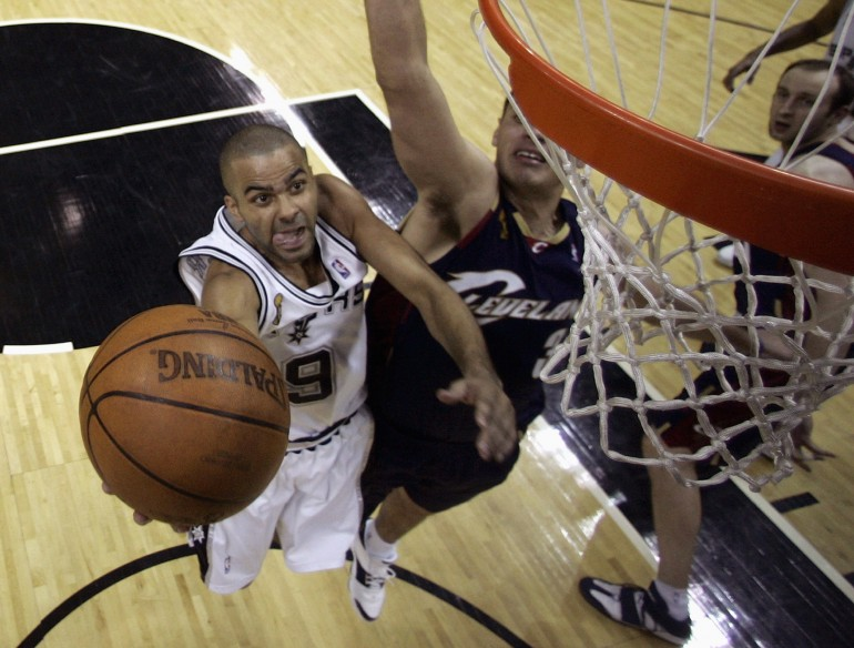 San Antonio Spurs' Tony Parker makes a shot while being defended by Cleveland Cavaliers' Sasha Pavlovic in the 2007 NBA FInals.