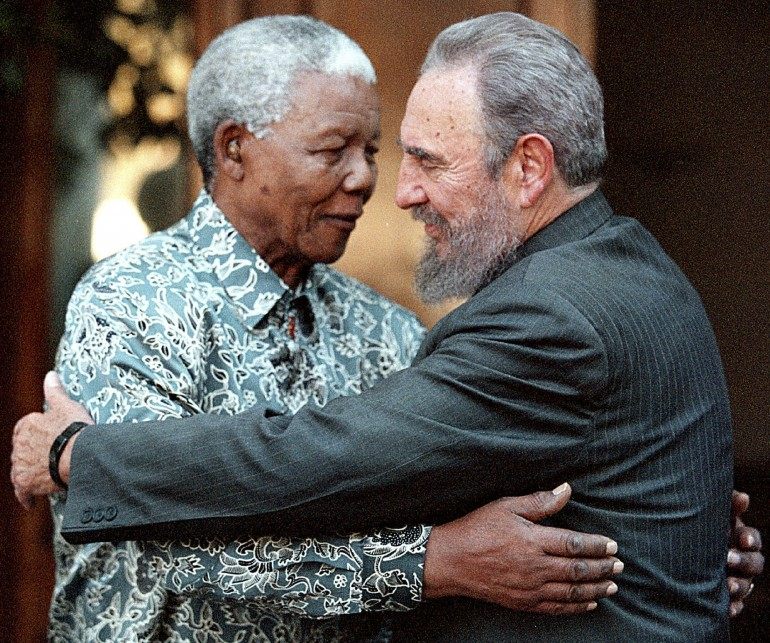 Former South African President Nelson Mandela (L) hugs Cuba's President Fidel Castro during a visit to Mandela's home in Houghton, Johannesburg in this September 2, 2001 file photo.
