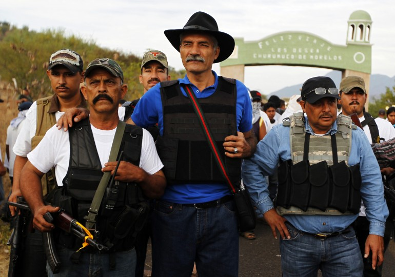 Autodefensa board leader Jose Manuel Mireles and militia members.
