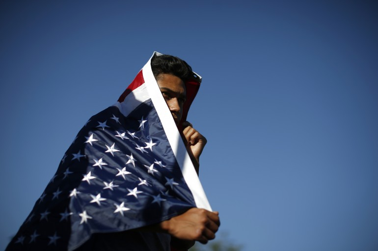 immigrant supporter in a flag