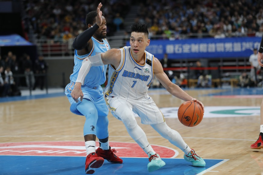 Jeremy Lin #7 of Beijing Ducks and Kay Felder #1 of Xinjiang Yilite