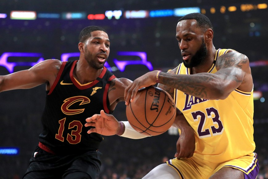 Tristan Thompson #13 of the Cleveland Cavaliers defends against LeBron James #23 of the Los Angeles Lakers