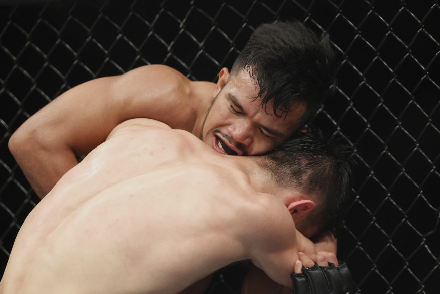 Rolando Dy of Phillippines fights with Wuliji Buren during the UFC Fight Night at Mercedes-Benz Arena