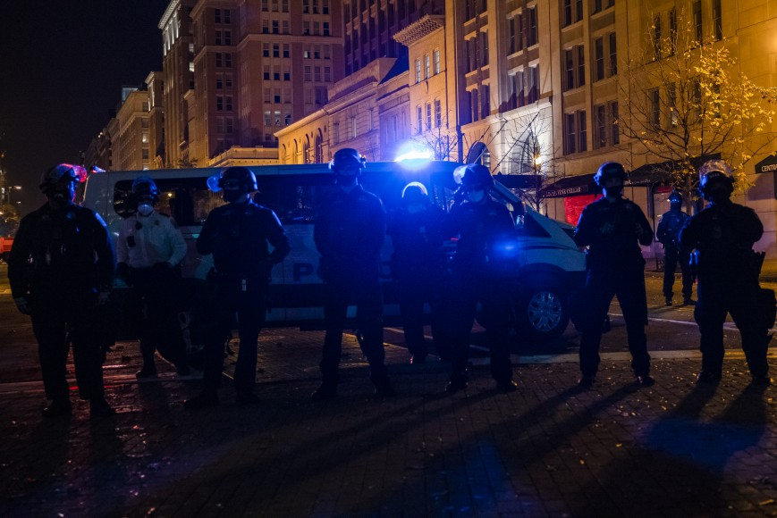 """Police block off a street from an Antifa group prior to clashes with a group of Proud Boys following the """"Million MAGA March"""""""