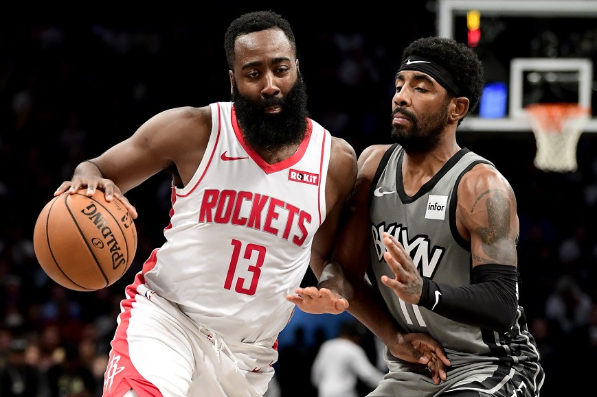 James Harden #13 of the Houston Rockets is defended by Kyrie Irving #11 of the Brooklyn Nets