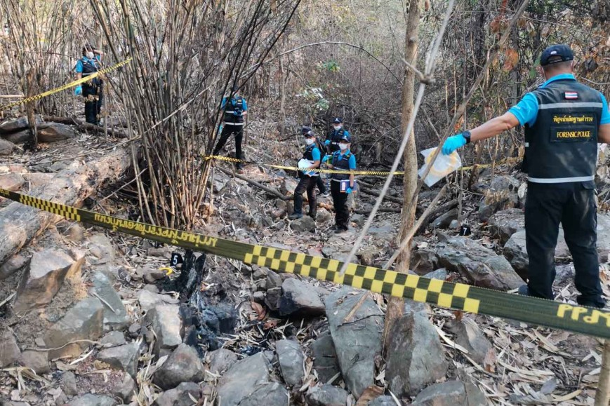 Forensic police at the scene in a rubber plantation where the burned remains, believed to be of a missing 19-year-old woman, were found on Tuesday morning, in Wang Thong district, Phitsanulok.