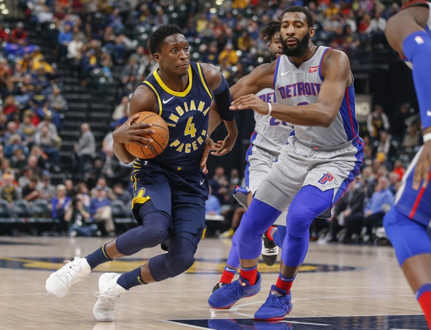 Victor Oladipo #4 of the Indiana Pacers drives to the basket against Andre Drummond #0 of the Detroit Pistons