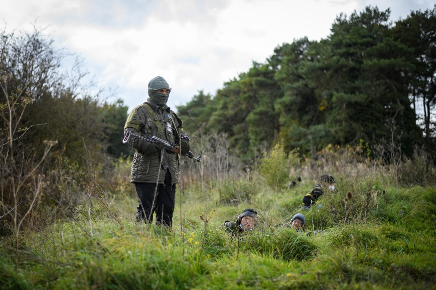 Role-play actors prepare to take part in an ambush during a Mission Rehearsal Exercise ahead of the UK Task Group deployment to Mali, on the Ministry of Defence training area on Salisbury Plain