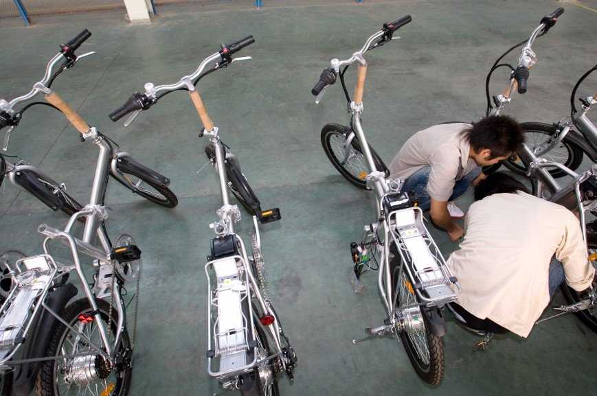 Workers work on electric bicycles in Repow electric vehicles factory on September 17, 2007 in Jinhua, Zhejiang province, China.