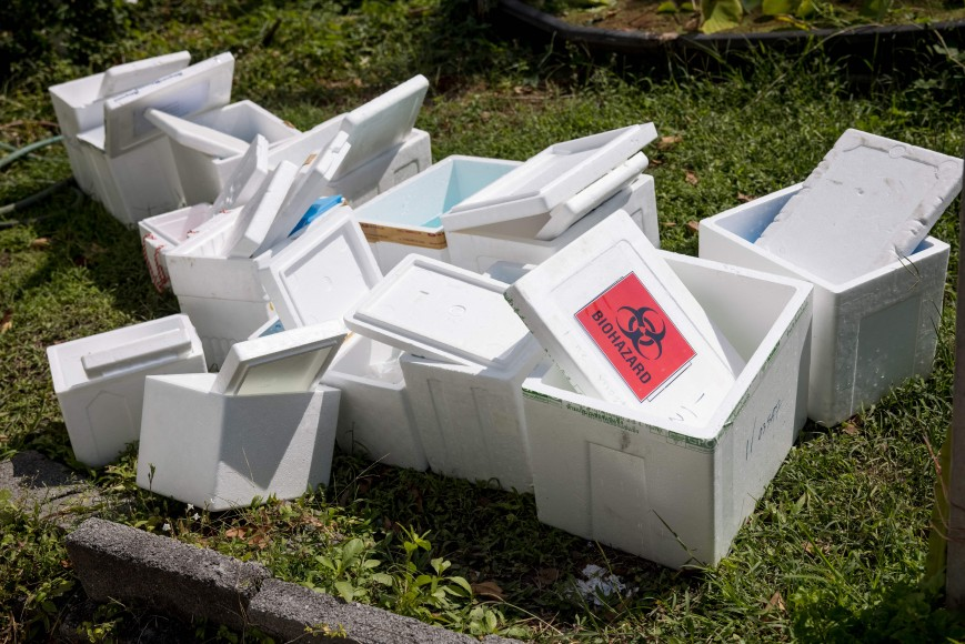 Polystyrene boxes labelled 'biohazard' sit outside the Urban Institute for Disease Prevention and Control in Bangkok