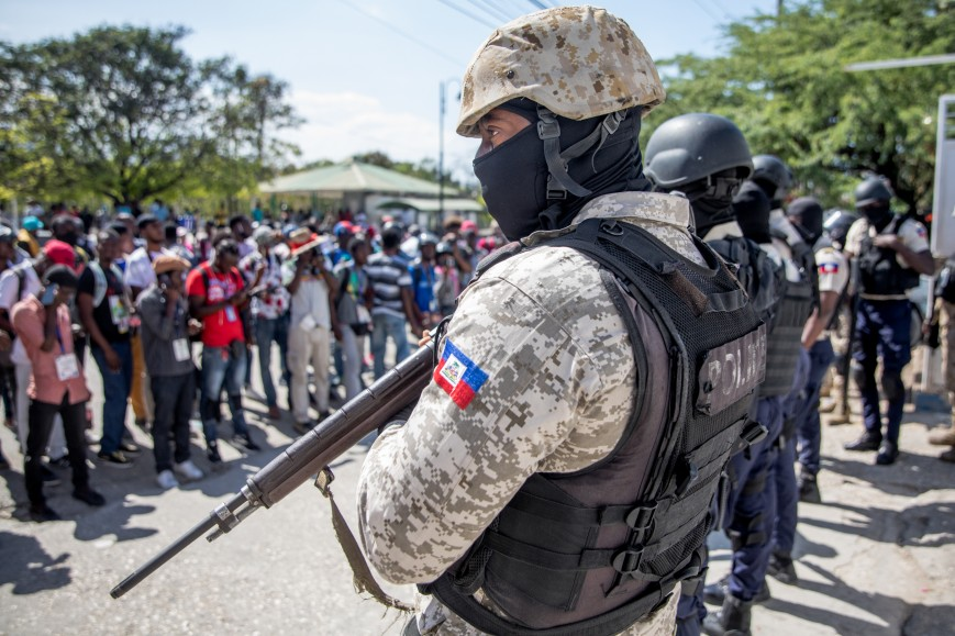 Journalists face armed police