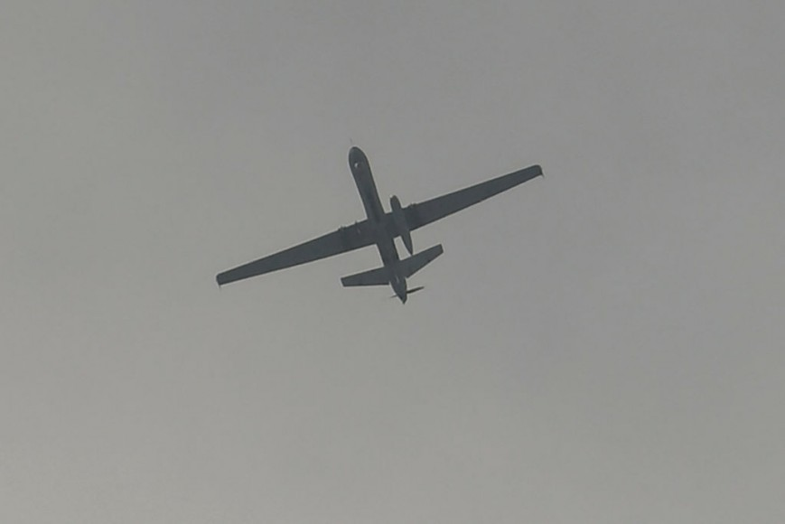 A drone flies over the airport in Kabul