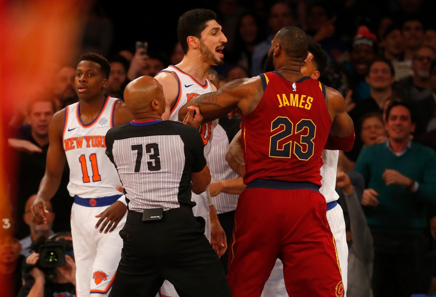 Enes Kanter #00 of the New York Knicks confronts LeBron James #23 of the Cleveland Cavaliers