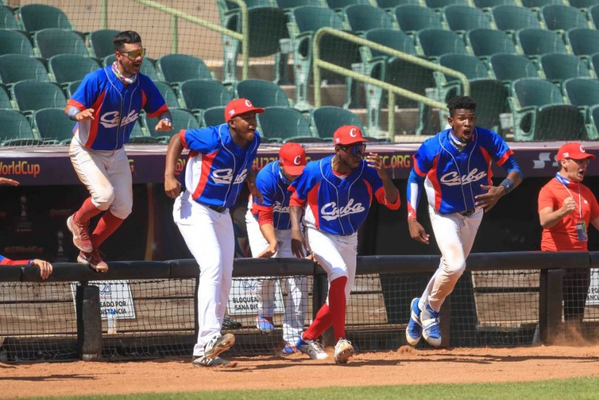 Players of the Cuba run out of the dugout to celebrate victory after the game