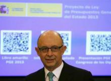 Spain debt rises on aid to banks, regions, finance cost