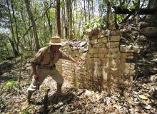 A National Institute of Anthropology and History (INAH) worker shows the remains of a building at the newly discovered ancient Maya city Chactun in Yucatan peninsula.