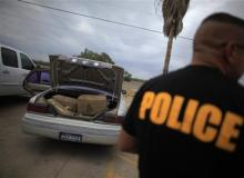 A car filled with bales of marijuana at a police station in La Grulla, Texas this March.