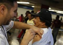 A man gets the flu vaccine in Mexico City.