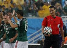 Mexico's players celebrate beating Cameroon