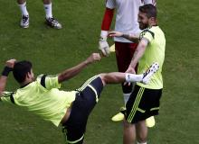 Spanish players mess around during a training session