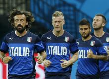 Players from Italy jog during a training session
