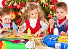 Kids making crafts for Christmas.