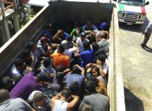 immigrants in a truck