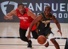 Eric Gordon #10 of the Houston Rockets defends as Chris Paul #3 of the Oklahoma City Thunder