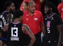 Doc Rivers of the LA Clippers talks with Montrezl Harrell #5 of the LA Clippers and Paul George #13 of the LA Clippers