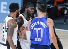 Montrezl Harrell of the LA Clippers and Luka Doncic #77 of the Dallas Mavericks
