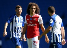 Matteo Guendouzi of Arsenal confronts Neal Maupay of Brighton and Hove Albion