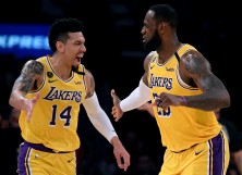 LeBron James #23 of the Los Angeles Lakers celebrates his basket with Danny Green #14