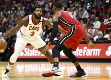 Andre Drummond #3 of the Cleveland Cavaliers dribbles against Bam Adebayo #13 of the Miami Heat