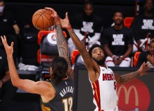 Steven Adams #12 of the Oklahoma City Thunder catches a pass against Derrick Jones Jr. #5 of the Miami Heat