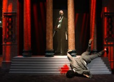 """A life-size grisly murder scene draws attention to the exhibit of the violent video game, """"Hitman 2 Silent Assassin"""""""