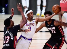 Rajon Rondo #9 of the Los Angeles Lakers drives to the basket against Jimmy Butler #22 of the Miami Heat and Bam Adebayo #13 of the Miami Heat