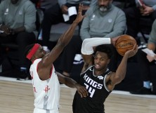 Buddy Hield #24 of the Sacramento Kings passes around the defense of Danuel House Jr. #4 of the Houston Rockets