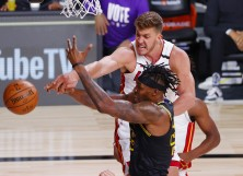 Meyers Leonard #0 of the Miami Heat defends Dwight Howard #39 of the Los Angeles Lakers