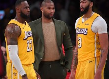 LeBron James #23 and Anthony Davis #3 talk with DeMarcus Cousins #15 of the Los Angeles Lakers