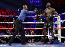 Referee Kenny Bayless sends Deontay Wilder to his corner during the Heavyweight bout for Wilder's WBC and Fury's lineal heavyweight title against Tyson Fury
