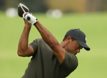 Tiger Woods of the United States plays his shot off the 17th tee during the first round of the Masters at Augusta National Golf Club