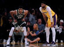 Giannis Antetokounmpo #34 of the Milwaukee Bucks and Anthony Davis #3 of the Los Angeles Lakers
