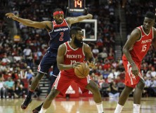 James Harden #13 of the Houston Rockets drives to the basket defended by John Wall #2 of the Washington Wizards