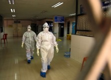 Health officials in full protective gear
